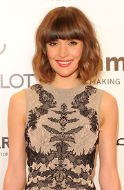 Rose Byrne wore her hair in subtle waves with heavy lash-grazing bangs at the 2012 amfAR Gala.