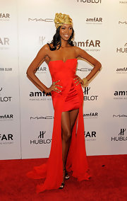 Jessica White donned a red strapless fishtail dress to the amfAR Fashion Week gala.