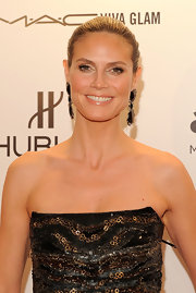 Heidi Klum wore a neutral shades of shadow and a glossy beige lipstick at the 2012 amfAR Gala.