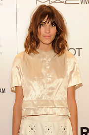 Alexa Chung wore her lengthy wavy page boy slightly mussed at the amfAR Gala.