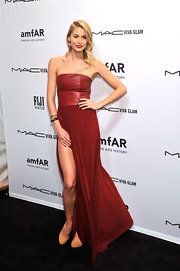 Lena Gercke looked luxe and sexy in this strapless burnt red gown with a leather bodice and hip-high slit.