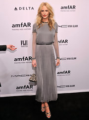 Poppy Delevingne never gets it wrong on the red carpet. We love this silky gray number she wore to the amfAR New York Gala.