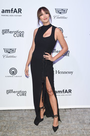 Jackie Cruz was modern, sexy, and edgy in a black cutout gown with lace-up detailing at the amfAR generationCURE Solstice 2017.