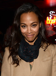 Zoe Saldana left her locks loose with subtle waves when she attended the boohoo.com event.