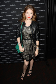 Anna Kendrick added a splash of color to her all-black outfit with a green leather shoulder bag during the boohoo.com event.