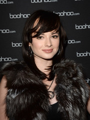 Ashley Rickards sported a hip layered cut with emo bangs when she attended the boohoo.com event.