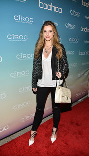 Bella Thorne teamed a plain white V-neck tee with a grommeted leather jacket for the boohoo.com flagship LA pop-up store opening.