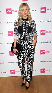 Laura Whitmore complemented her busy outfit with a simple black leather clutch when she attended the Very.co.uk launch party.