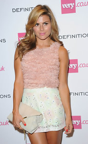 Zoe Hardman amped up the sweetness in a sleeveless pink ruffle blouse during the Very.co.uk launch party.