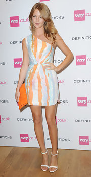 Millie Mackintosh teamed white evening sandals with a one-shoulder dress for a sophisticated look during the Very.co.uk launch party.