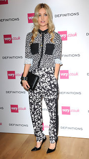 Laura Whitmore sported a busy ensemble at the Very.co.uk launch party, consisting of black-and-white print pants and a button-down.