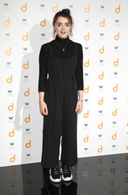 Maisie Williams attended the 'daisie' launch party wearing a pinstriped jumpsuit over a matching turtleneck.