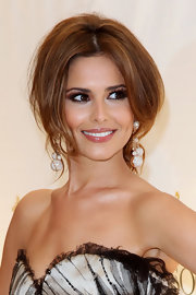 Cheryl Cole was a vision of light while attending the Cannes Film Festival. Her voluminous updo was the perfect complement to her strapless neckline.