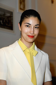Caroline Issa's red lipstick looked gorgeous against her yellow blouse.
