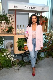 Hannah Bronfman layered a pink blazer over a lace top for the In goop Health Summit.