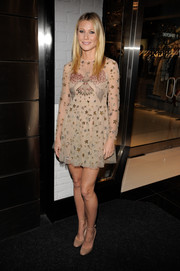 Gwyneth Paltrow matched her dress with simple nude ankle-strap pumps, also by Valentino.