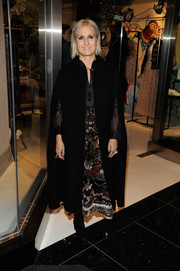 Maria Grazia Chiuri arrived for the Goop Mrkt grand opening wearing a classic black cape.