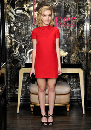 Kiernan Shipka chose a pair of strappy black peep-toes to complete her sweet ensemble.