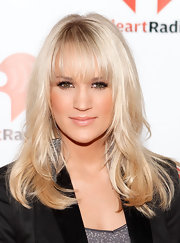 Carrie Underwood was ultra blonde at the iHeartRadio Music Festival. Her long, wavy locks were soft and silky and her lash-length bangs set off her eyes beautifully. To recreate her look, add a few curls with a large-barreled curing iron and tousle with fingers.