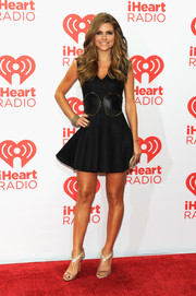 Maria Menounos finished off her look in glam style with a pair of bedazzled T-strap sandals.