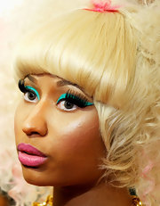Nicki Minaj had a lot of fun with her makeup at the iHeart Music Festival. Her cool, colorful take a retro eye is easy to duplicate. A product like M.A.C. Chromaline works perfectly for creating the look of liquid liner in the boldest, brightest colors. To apply, start at the inner corners of the eyes and sweep the liner  brush gently along the upper lash line, flicking the brush gently in an up and out motion at the outer corners, creating layers until you've gotten the desired thickness of the line.