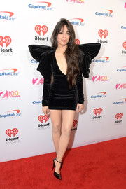 Camila Cabello teamed her frock with black patent pumps by Saint Laurent.