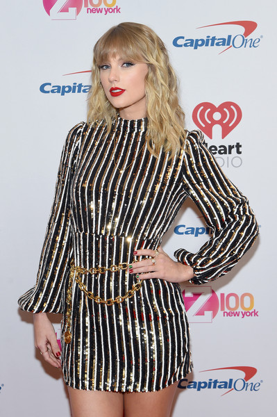 Taylor Swift paired a gold chain belt by Chanel with a sequined mini dress for iHeartRadio's Z100 Jingle Ball 2019.