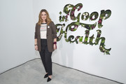 Drew Barrymore teamed black pumps with slacks and a tweed jacket for the In goop Health Summit.