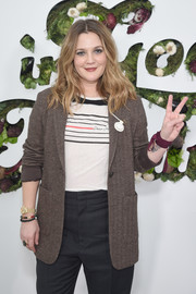 Drew Barrymore layered a brown blazer over a striped top for the In goop Health Summit.