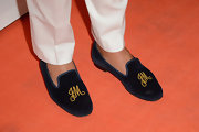 Joe Mimran was casual and cool on the red carpet with these monogrammed smoking slippers.
