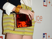 Louise Roi chose a funky orange clutch with gold chain to add a bit of a modern look to her classically preppy outfit.
