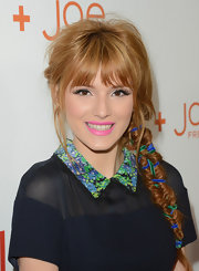 Bella Thorne added some color to her cool fishtail braid by weaving blue and green ribbon through her hair.