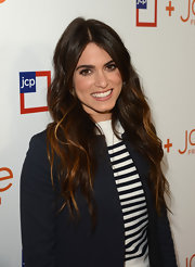 Nikki Reed showed off her cool brunette tresses with this long wavy 'do with gorgeous auburn highlights.