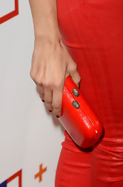 Noureen DeWulf opted for a classic red clutch for her evening look.