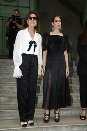 Charlotte Casiraghi paired her frock with strappy black pumps.