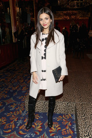 Victoria Justice kept warm in classic style with a cream-colored wool coat by Kate Spade while attending the label's fashion presentation.