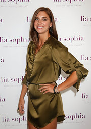 Alex Morgan accented her slouchy shirtdress with glittery bangles.