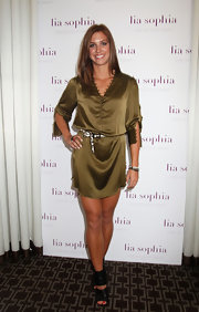 Alex Morgan stepped out at a Lia Sophia event in black patent gladiator heels that showed off her bright red pedicure.
