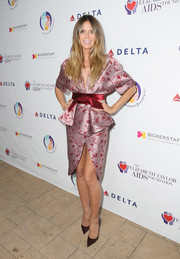 Heidi Klum went the ultra feminine route in a lavender Johanna Ortiz floral dress with a peplum waist and a high front slit at the mothers2mothers and Elizabeth Taylor AIDS Foundation benefit dinner.