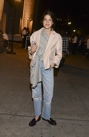 Leandra Medine layered a nude leather jacket over a frilly striped top for the rag & bone fashion show.