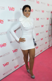Toni was white hot at her 'Braxton Family Values' celebration in a white knit dress with a ruffled neck design.