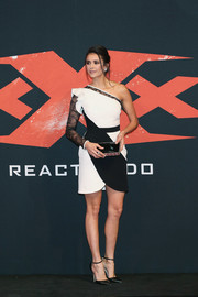 Nina Dobrev looked hip in a black-and-white one-sleeve mini dress by Elie Saab at the world premiere of 'xXx: Return of Xander Cage.'