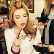 Bella Thorne Applies Lipstick