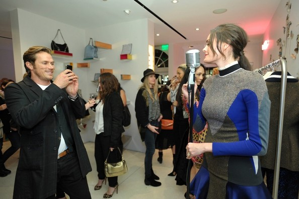 Jason Lewis Snaps a Photo at the Stella McCartney LA Holiday Party