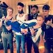 Cara Delevingne Gets Carried by Boys at a Shoot