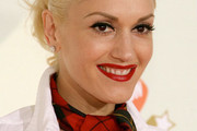Signature Style: Gwen Stefani Loves Plaid Prints and Bombshell Beauty