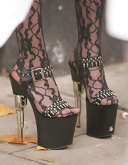 Taylor paired her lace tights with platform sandals, which were embellished with gun bullets.