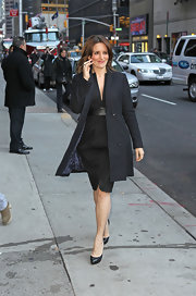 Tina Fey wore a little black dress with an evening coat for her 'Letterman' appearance.