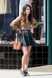 Shenae Grimes stayed within her outfit's color scheme with these tan, grey, and brown peep-toe wedges.
