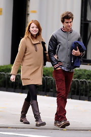 Emma Stone enjoyed a walk through NYC in a loose camel coat with leather straps.